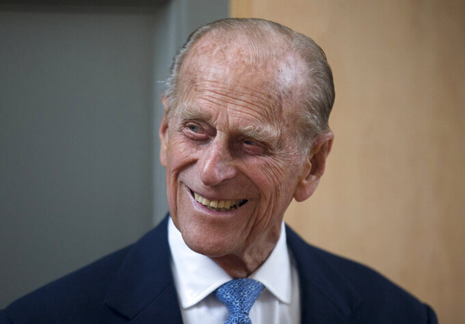 FILE - In this June 8, 2015 file photo Britain's Prince Philip, the husband of Queen Elizabeth II, smiles after unveiling a plaque at the end of his visit to Richmond Adult Community College in Richmond, south west London. Prince Philip, the irascible and tough-minded husband of Queen Elizabeth II who spent more than seven decades supporting his wife in a role that both defined and constricted his life, has died, Buckingham Palace said Friday. He was 99. (AP Photo/Matt Dunham, File)