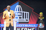 Harold Carmichael, a member of the Pro Football Hall of Fame Centennial Class, speaks during the induction ceremony at the Pro Football Hall of Fame, Saturday, Aug. 7, 2021, in Canton, Ohio. (AP Photo/David Richard)