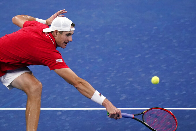 John Isner, of the United States, returns to Steve Johnson, of the United States, during the first round of the US Open tennis championships, Monday, Aug. 31, 2020, in New York. (AP Photo/Frank Franklin II)