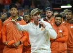 FILE - In this Saturday, Jan. 12, 2019 file photo, Clemson head football coach Dabo Swinney along with members of the 2019 National Championship football team address the crowd during the first half of an NCAA college basketball game between Clemson and Virginia in Clemson, S.C. Clemson just keeps on winning on the football field, and in recruiting. Less than a month after the Tigers won their second national championship in three years, they polished off the best class in the Atlantic Coast Conference on Wednesday, Feb. 6, 2019, the first day of the traditional signing period .(AP Photo/Richard Shiro, File)