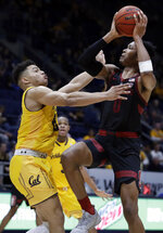 Stanford's KZ Okpala, right, shoots against California's Matt Bradley in the second half of an NCAA college basketball game Sunday, Feb. 3, 2019, in Berkeley, Calif. (AP Photo/Ben Margot)