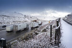 Traffic moves north along the Interstate 5 near the Tejon Pass as travelers try to get in and out of Southern California for the Thanksgiving holiday, Wednesday, Nov. 27, 2019, near Gorman, Calif.. Plows were running and CHP was guiding traffic in an attempt to keep the freeway open as long as possible.(David Crane/The Orange County Register via AP)