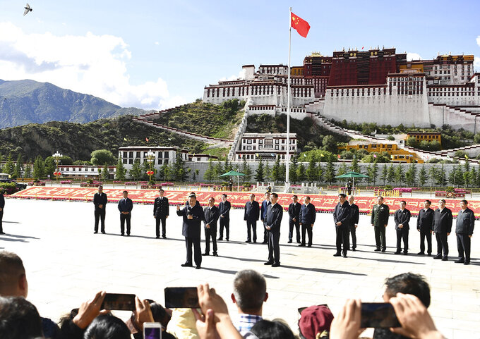 In this July 22, 2021 photo released by China's Xinhua News Agency, Chinese President Xi Jinping speaks at a public square below the Potala Palace in Lhasa in western China's Tibet Autonomous Region. Chinese leader Xi Jinping has made a rare visit to Tibet as authorities tighten controls over the Himalayan region's traditional Buddhist culture, accompanied by an accelerated drive for economic development. (Yan Yan/Xinhua via AP)