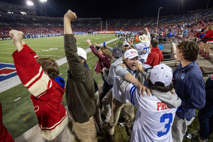 Fans in the SMU students section cheer during the second half of an NCAA college football game against Cincinnati Saturday, Oct. 24, 2020, in Dallas. Cincinnati won 42-13. (AP Photo/Jeffrey McWhorter)