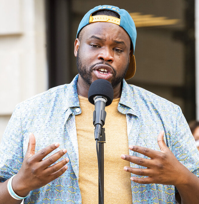 "Tears roll down the face of Vauhxx Booker as he speaks to the hundreds gathered at the Monroe County courthouse, Monday, July 6, 2020, in Bloomington, Ind. Booker, a local civil rights activist and member of the Monroe County Human Rights Commission, says a group of white men assaulted him and threatened to ""get a noose"" after claiming that he and his friends had trespassed on private property as they gathered at an Indiana lake over the Fourth of July weekend. (Rich Janzaruk/The Herald-Times via AP)"