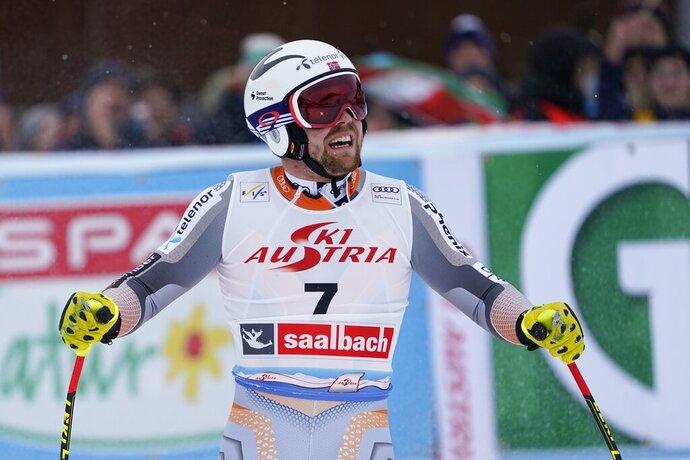 Norway's Aleksander Aamodt Kilde celebrates at the finish area of an alpine ski, men's World Cup Super G, in Saalbach-Hinterglemm, Austria, Friday, Feb. 14, 2020. (AP Photo/Giovanni Auletta)