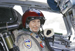 FILE - In this file photo taken on Tuesday, Aug. 16, 2005, Russian President Vladimir Putin wearing a jump suit sits in the cockpit of a supersonic strategic bomber ready to leave for a training mission, in Moscow, Russia. Russian President Vladimir Putin prepares to mark his 20th year in power, as the longest-serving leader since Joseph Stalin. (Sputnik, Kremlin Pool Photo via AP, File)