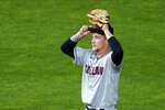 Cleveland Indians pitcher Zach Plesac adjusts his cap after giving up a two-run home run to Minnesota Twins' Marwin Gonzalez in the second inning of a baseball game Saturday, Sept. 12, 2020, in Minneapolis. (AP Photo/Jim Mone)