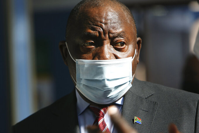FILE — In this Thursday, July 29, 2021 file photo South African President Cyril Ramaphosa visits a COVID-19 vaccination centre in Tembisa, South Africa. After uncertainty if COVID-19 would bring the country to postpone local government elections the courts have ruled that the crucial polls should move ahead and would be held on Nov. 1 2021. (AP Photo/File)