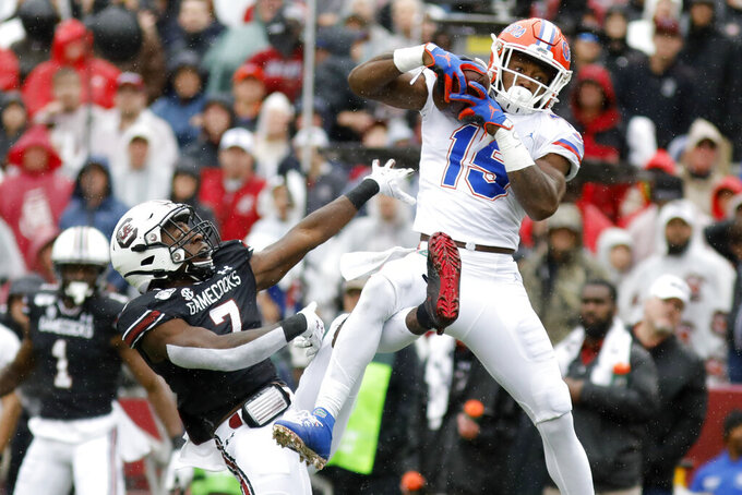 Florida's Jacob Copeland (15) catches a pass for a touchdown as South Carolina's Jammie Robinson (7) defends in the first half of an NCAA college football game Saturday, Oct. 19, 2019, in Columbia, SC. (AP Photo/Mic Smith)