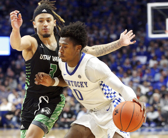 Kentucky's Ashton Hagans (0) drives against Utah Valley's TJ Washington (3) during the second half of an NCAA college basketball game in Lexington, Ky., Monday, Nov. 18, 2019. (AP Photo/James Crisp)