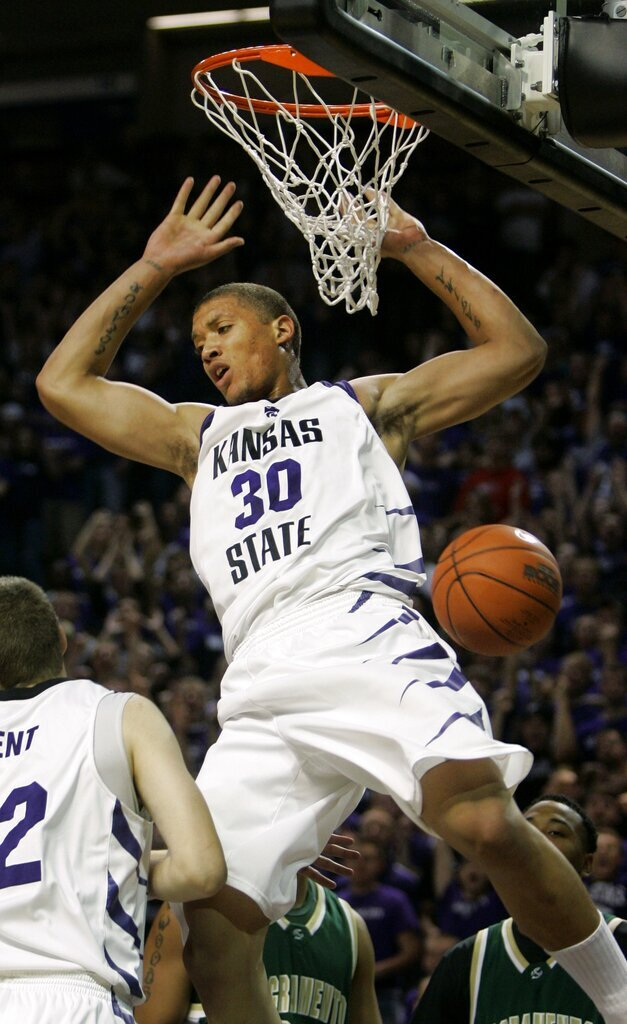 FILE - In this Nov. 9, 2007, file photo, Kansas State forward Michael Beasley dunks the ball during the first half of an NCAA college basketball game against Sacramento State in Manhattan, Kan. Beasley led all Division I players in rebounding (12.4) and ranked third in scoring (26.2) to earn first-team AP All-America honors his lone season at Kansas State. His 28 double-doubles that season remain the most ever by a Division I freshman. (AP Photo/Charlie Riedel, File)