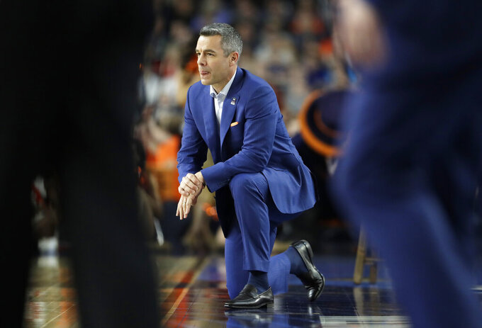 Virginia head coach Tony Bennett watches from the bench during the second half against Auburn in the semifinals of the Final Four NCAA college basketball tournament, Saturday, April 6, 2019, in Minneapolis. (AP Photo/Jeff Roberson)