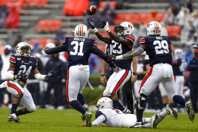 Auburn defensive back Roger McCreary (23) fields the ball after Samford quarterback Chris Oladokun (2) fumbled it during the first half of an NCAA college football game, Saturday, Nov. 23, 2019, in Auburn, Ala. (AP Photo/Butch Dill)
