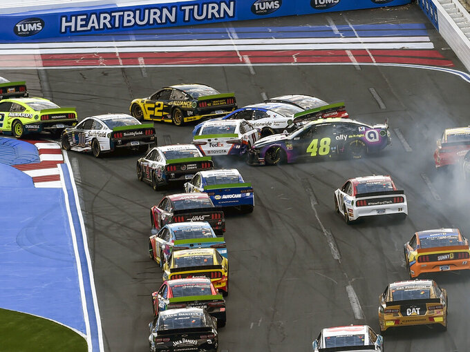 Jimmie Johnson (48) spins going into Turn 1 hitting the cars of Denny Hamlin (11) and Alex Bowman (88) during a NASCAR Cup Series auto race at Charlotte Motor Speedway, Sunday, Sept. 29, 2019 in Concord, N.C. (AP Photo/Mike McCarn)
