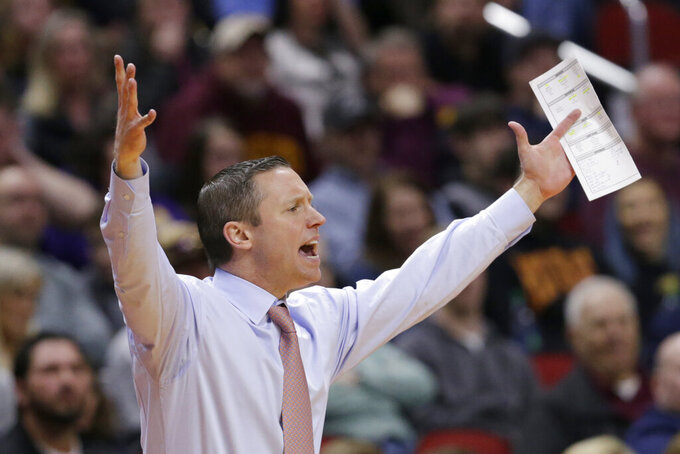 Florida coach Mike White calls instructions during the first half of a second round men's college basketball game against Michigan in the NCAA Tournament, in Des Moines, Iowa, Saturday, March 23, 2019. (AP Photo/Nati Harnik)