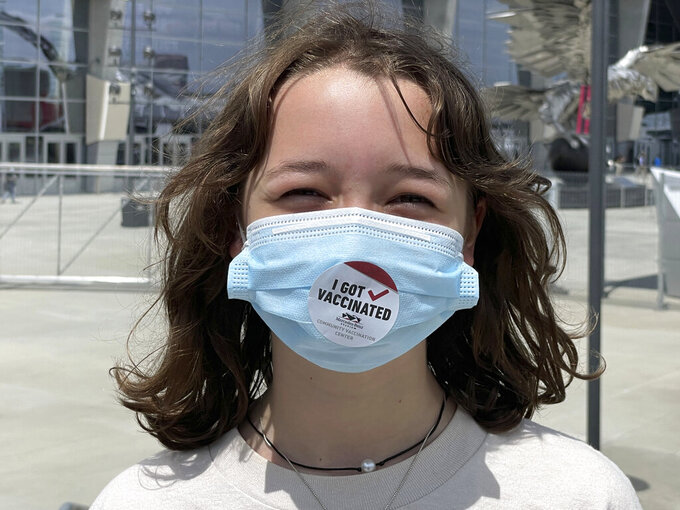 Jane Ellen Norman, 12, poses for a photo outside Mercedes-Benz Stadium in Atlanta on Tuesday, May 11, 2021. Jane Ellen and her 14-year-old brother Owen were vaccinated Tuesday morning, after U.S. regulators expanded use of Pfizer's COVID-19 shot to those as young as 12. (AP Photo/Angie Wang)