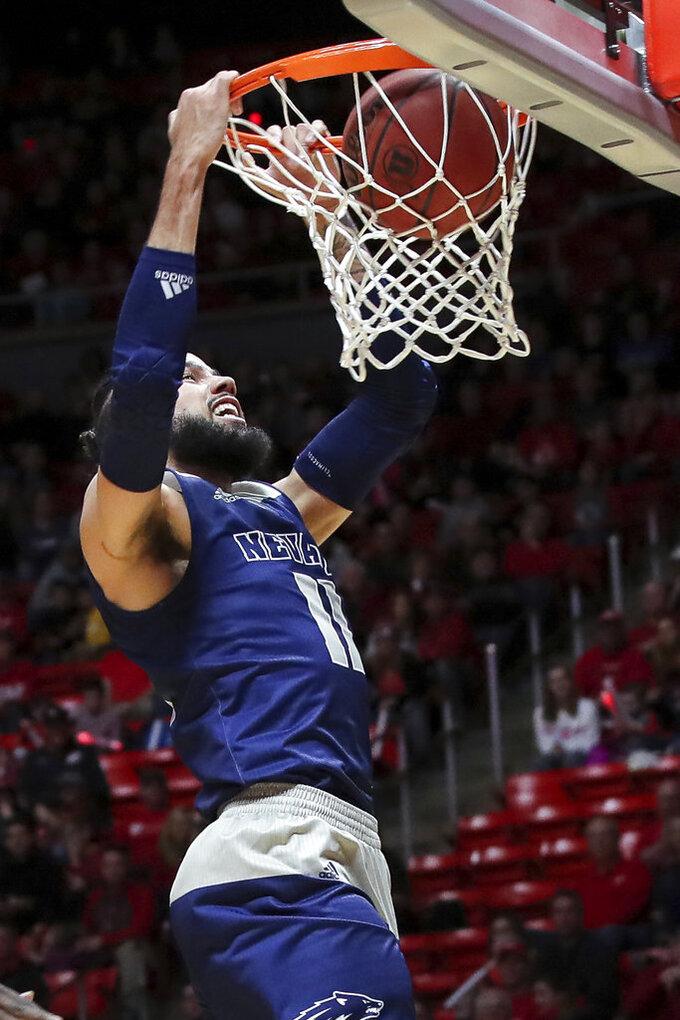 Nevada forward Cody Martin (11) dunks the basketball against Utah during the first half of an NCAA college basketball game, Saturday, Dec. 29, 2018, in Salt Lake City. (AP Photo/Chris Nicoll)