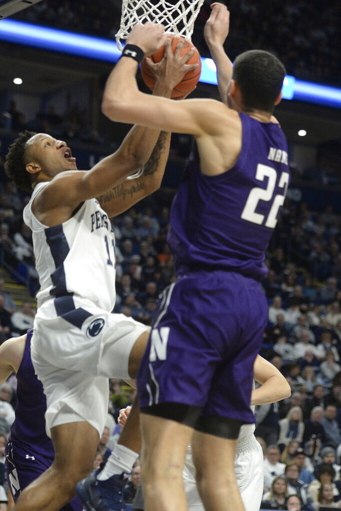 Penn State's Lamar Stevens,left, goes to the basket as Northwestern's Pete Nance (22) defends during the first half of an NCAA college basketball game, Saturday, Feb. 15, 2020, in State College, Pa. (AP Photo/Gary M. Baranec)