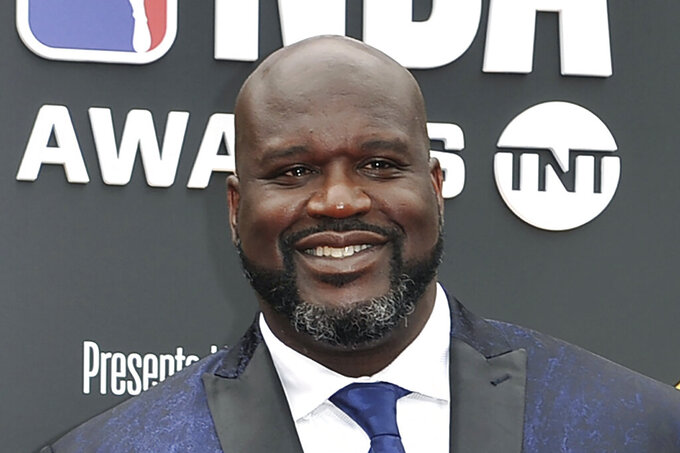 """FILE - This June 24, 2019, file photo shows Shaquille O'Neal at the NBA Awards in Santa Monica, Calif. A woman whose car was left stranded along a Florida interstate when her tire blew out got a little unexpected help from former NBA star Shaquille O'Neal, sheriff's officials say. O'Neal, who lives in the Orlando area, was traveling on Interstate 75 near Gainesville on Monday, July 13, 2020, when he saw the woman pull onto the side of the road, the Alachua County Sheriff's Office said on a Facebook post. He stayed with the woman until deputies arrived at the scene. """"He fist-bumped Deputies Purington and Dillon before going on his way,"""" the sheriff's office wrote on Facebook.  (Photo by Richard Shotwell/Invision/AP, File)"""