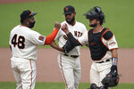 San Francisco Giants' Pablo Sandoval (48) celebrates with Jarlin Garcia, center, and Joey Bart after the Giants defeated the Arizona Diamondbacks in a baseball game in San Francisco, Sunday, Aug. 23, 2020. (AP Photo/Jeff Chiu)