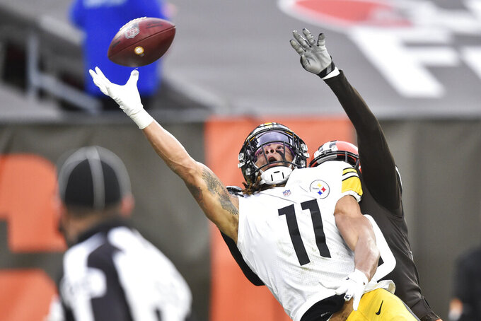 Pittsburgh Steelers wide receiver Chase Claypool (11) cannot make a catch during the second half of an NFL football game against the Cleveland Browns, Sunday, Jan. 3, 2021, in Cleveland.  (AP Photo/David Richard)