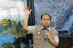 In this March 18, 2019, photo, National Disaster Mitigation Agency spokesman Sutopo Purwo Nugroho speaks during a press conference in Jakarta, Indonesia. Indonesia's disaster agency spokesman Nugroho who was respected for informing Indonesians accurately and quickly about the country's frequent natural calamities, has died on Sunday, July 7, 2019, in Guangzhou, China, where he had been undergoing medical treatment since June. (AP Photo/Tatan Syuflana)
