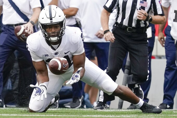 Penn State's Noah Cain catches a pass during the first half of an NCAA college football game against Wisconsin Saturday, Sept. 4, 2021, in Madison, Wis. (AP Photo/Morry Gash)