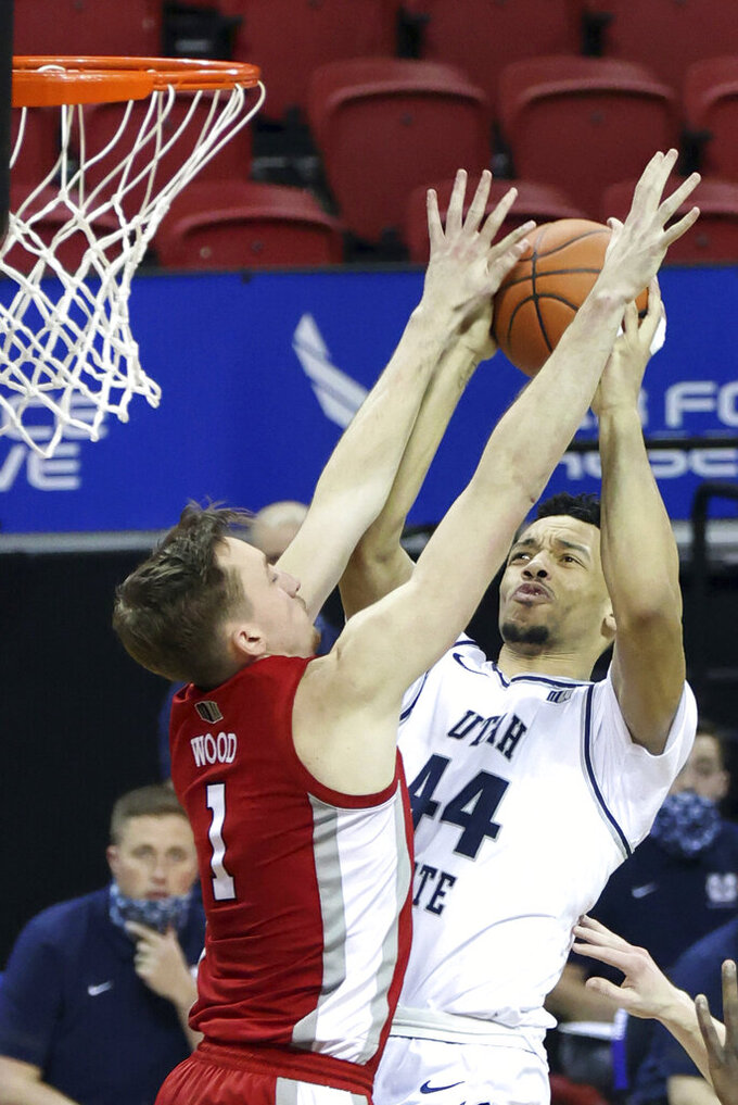 Utah State guard Marco Anthony (44) shoots as UNLV forward Moses Wood (1) defends during the second half of an NCAA college basketball game in the quarterfinals of the Mountain West Conference men's tournament Thursday, March 11, 2021, in Las Vegas. (AP Photo/Isaac Brekken)