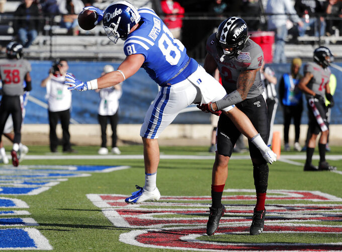 Temple safety Delvon Randall (2) upends Duke tight end Davis Koppenhaver (81) as he scores on a 4-yard pass in the second half of the Independence Bowl NCAA college football game in Shreveport, La., Thursday, Dec. 27, 2018. (AP Photo/Rogelio V. Solis)