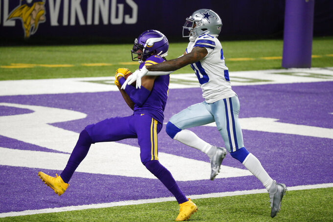 Minnesota Vikings wide receiver Justin Jefferson catches a 39-yard touchdown pass ahead of Dallas Cowboys cornerback Anthony Brown, right, during the second half of an NFL football game, Sunday, Nov. 22, 2020, in Minneapolis. (AP Photo/Bruce Kluckhohn)