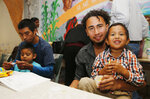 CORRECTS SON'S AGE TO 4, NOT 3 - Roger Ardino, 24, and his son Roger Ardino Jr., 4, pose for a photo as they and Pablo Ortiz, 28, left, and his son Andres were speaking to members of the media during a news conference at the Annunciation House in El Paso, Texas, Wednesday, July 11, 2018. Ardino and Pablo Ortiz and his son Andres spoke to the media about their experiences while being detained and separated for several months from their sons. Tuesday night three fathers were reunited with their children but only two spoke this morning after the third, a father and daughter, had already left El Paso early Wednesday morning. (Ruben R. Ramirez/The El Paso Times via AP)