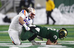 Boise State defensive tackle David Moa, left, sacks Colorado State quarterback Patrick O'Brien in the second half of an NCAA college football game Friday, Nov. 29, 2019, in Fort Collins, Colo. Boise State won 31-24. (AP Photo/David Zalubowski)