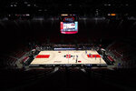 UCLA plays San Diego State in front of empty stands at Viejas Arena during the first half of an NCAA college basketball game Wednesday, Nov. 25, 2020, in San Diego. (AP Photo/Gregory Bull)
