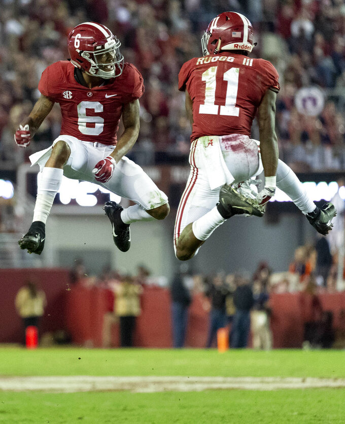 Alabama wide receivers DeVonta Smith (6) and Henry Ruggs III (11) celebrate a touchdown reception by Ruggs during the second half of an NCAA college football game against Auburn, Saturday, Nov. 24, 2018, in Tuscaloosa, Ala. (AP Photo/Vasha Hunt)