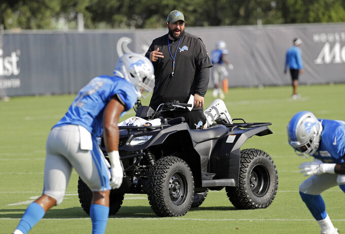 Detroit Lions coach Matt Patricia instructs players during a joint NFL training camp football practice with the Houston TexansThursday, Aug. 15, 2019, in Houston. (AP Photo/David J. Phillip)