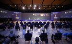 People listen as Russian President Vladimir Putin, center left, speaks at the St. Petersburg International Economic Forum in St. Petersburg, Russia, Friday, June 4, 2021. (Sergei Bobylev/TASS News Agency Pool Photo via AP)