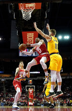Houston Rockets' Russell Westbrook (0) goes up for a shot as Indiana Pacers' Domantas Sabonis (11) defends during the first half of an NBA basketball game Friday, Nov. 15, 2019, in Houston. (AP Photo/David J. Phillip)