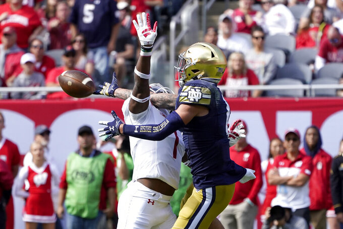 Wisconsin cornerback Faion Hicks, left, breaks up a pass intended for Notre Dame wide receiver Braden Lenzy during the first half of an NCAA college football game Saturday, Sept. 25, 2021, in Chicago. (AP Photo/Charles Rex Arbogast)