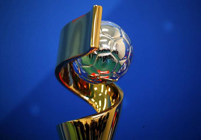 The Women's soccer World Cup trophy is on display during its presentation in a Paris school, Tuesday, May 14, 2019. When FIFA released its global strategy for women's soccer last year, it was met by some skepticism. But soccer's governing body is making some strides in implementing the long-range plan, against a backdrop of this summer's World Cup in France.  (AP Photo/Christophe Ena)
