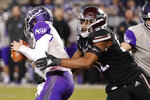 Mississippi State defensive end Kobe Jones (52) pressures Abilene Christian quarterback Luke Anthony (3) during the second half of an NCAA college football game, Saturday, Nov. 23, 2019, in Starkville, Miss. Mississippi State won 45-7. (AP Photo/Rogelio V. Solis)