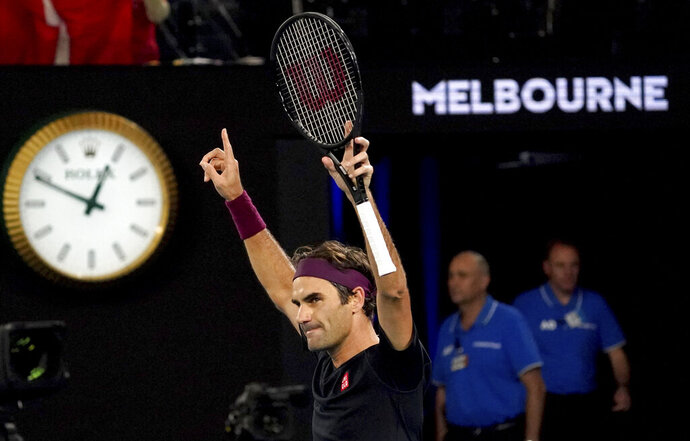 Switzerland's Roger Federer celebrates after defeating Australia's John Millman in their third round match at the Australian Open tennis championship in Melbourne, Australia, Saturday, Jan. 25, 2020.(AP Photo/Lee Jin-man)