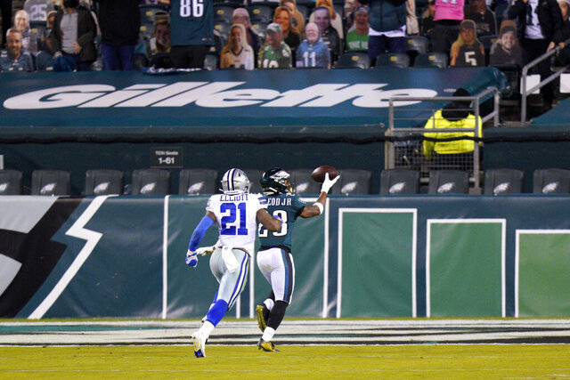 Philadelphia Eagles' Travis Fulgham (13) scores a touchdown past Dallas Cowboys' Ezekiel Elliott (21) after recovering a fumble during the second half of an NFL football game, Sunday, Nov. 1, 2020, in Philadelphia. (AP Photo/Chris Szagola)