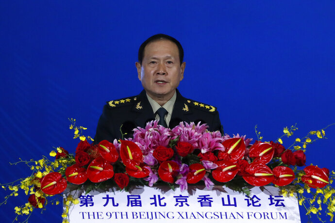 Chinese Defense Minister Wei Fenghe delivers his opening speech for the Xiangshan Forum, a gathering of the region's security officials, in Beijing, Monday, Oct. 21, 2019. Wei issued a stinging rebuke of the U.S. at a defense forum in Beijing, saying China wasn't fazed by sanctions, pressure and a