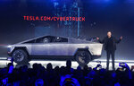 "FILE - In this Nov. 21, 2019 file photo, Tesla CEO Elon Musk introduces the Cybertruck at Tesla's design studio in Hawthorne, Calif.  The much-hyped unveil of Tesla's electric pickup truck went off script Thursday night when supposedly unbreakable window glass shattered twice when hit with a large metal ball. The failed stunt, which ranks high on the list of embarrassing auto industry rollouts, came just after Musk bragged about the strength of ""Tesla Armor Glass"" on the wedge-shaped ""Cybertruck."" (AP Photo/Ringo H.W. Chiu, File)"
