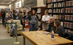 Danica Patrick, right, poses for a photo as fans wait in line during a book signing in Charlotte, N.C., Thursday, Jan. 4, 2018. The transition from race car driver to businesswoman was swift, and Patrick is now adjusting to a new celebrity life that doesn't include driving cars. She hawked her new book all last week, and held her first organized book signing. (AP Photo/Chuck Burton)