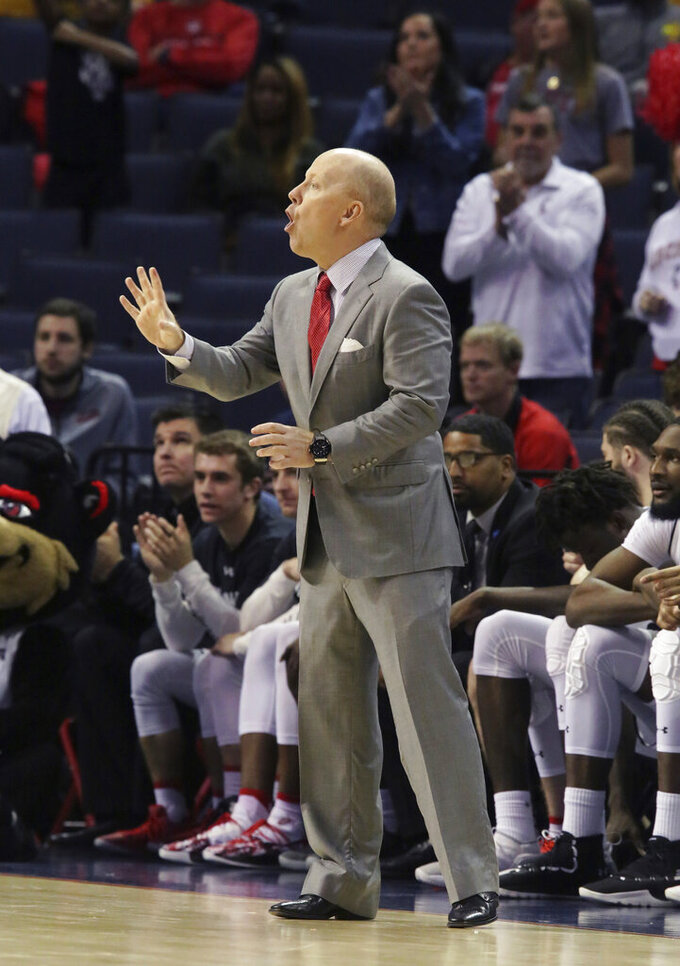 Cincinnati coach Mick Cronin yells to his players during the second half of the team's NCAA college basketball game against SMU at the American Athletic Conference men's tournament Friday, March 15, 2019, in Memphis, Tenn. (AP Photo/Troy Glasgow)