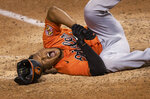 Baltimore Orioles' Pedro Severino (28) grimaces as he falls to the ground after getting hit by a pitch during the ninth inning of the team's baseball game against the Washington Nationals in Washington, Saturday, Aug. 8, 2020. The Orioles won 5-3. (AP Photo/Manuel Balce Ceneta)