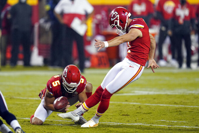Kansas City Chiefs place kicker Harrison Butker, right, kicks a 19-yard field goal in the second half of an NFL football game against the Houston Texans Thursday, Sept. 10, 2020, in Kansas City, Mo. (AP Photo/Jeff Roberson)