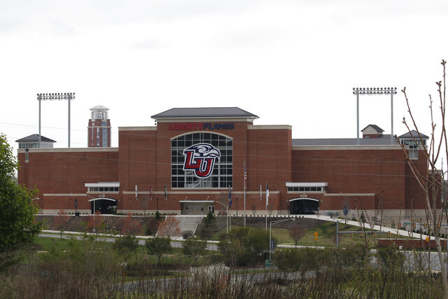 Liberty University's football stadium is empty as students were welcomed back to the university's campus, Tuesday March 24 , 2020, in Lynchburg, Va. Officials in Lynchburg, said Tuesday they were fielding complaints and concerns about the hundreds of students that have returned from their spring break to Liberty University, where President Jerry Falwell Jr. has welcomed them back amid the coronavirus pandemic. (AP Photo/Steve Helber)